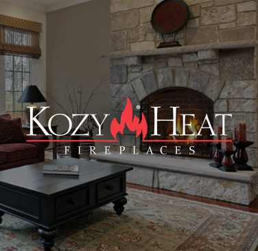 Kozy Heat Fireplaces logo in center of home fireplace in living room.