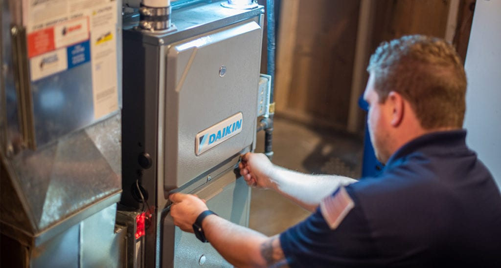 Bears Home Solutions certified specialist examines HVAC unit.